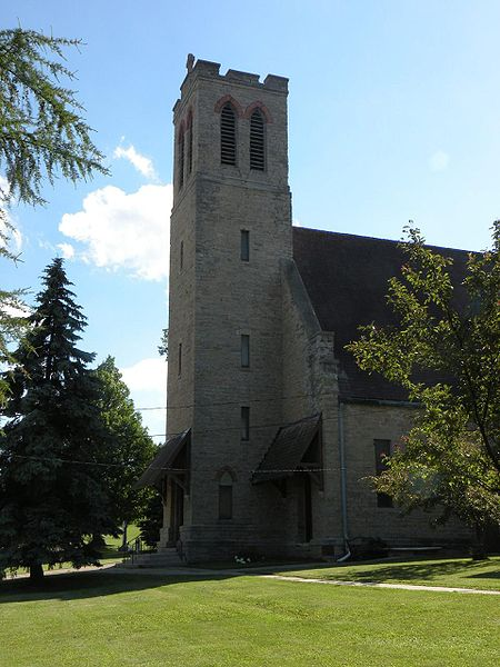 "Church of the Holy Apostles, Oneida, Wisconsin, where the People settled after the U.S. government forcibly removed them from New York State. Cornelius Hill was educated at nearby Nashotah House, a mission seminary, and became a chief while still in his teens. He was a vocal opponent of ""allotment,"" the forced division of tribal lands into private property; after it became law by act of Congress in 1893, he was ordained a deacon at age 61 and, at 69, the first Oneida priest. He and his parishioners built this church, which is still active, and there are shrines to him all over Wisconsin. (Matthew P. Payne)"