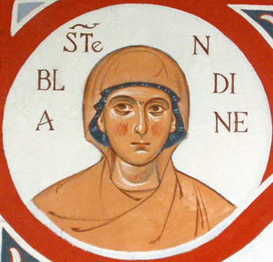St. Blandina, from the Chapel of the Dormition of the Mother of God in Drome, France. Blandina and other Christians were accused by hysterical mobs of cannibalism, incest and other crimes. Like St. Justin yesterday, Blandina and Companions were martyred during the reign of Marcus Aurelius.