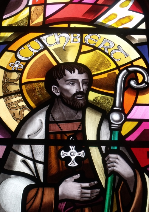 St. Cuthbert window at St. Michael's, Workington, England. Cuthbert was the most popular saint of pre-Conquest England; on receiving a vision of St. Aidan's death, he entered the religious life, was nurtured in the austere traditions of Celtic monasticism, became Prior of Melrose Abbey and then of Lindisfarne, as well as Bishop of Hexham. Like St. Hilda, he accepted the decision of the Synod of Whitby favoring the Roman liturgy over the Celtic for the sake of church unity - though millions have regretted it ever since. Canterbury was Roman and the Church did not need factions in the British Isles, so it is up to us to preserve the unique and earthy spirituality of the Celts, and their preference for the poor over the institutional church.