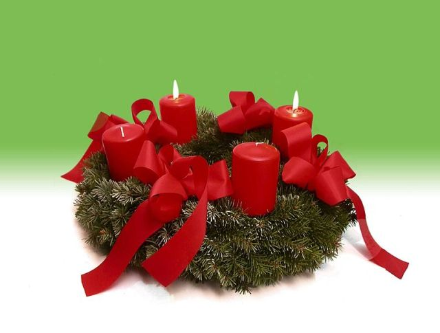 We light the second candle of our Advent wreath today; be careful, children.