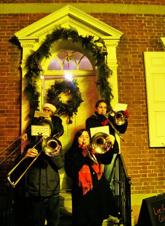 """From 2012: Bethlehem, Pennsylvania sponsors a nightly """"living Advent calendar"""" to draw people downtown. People gather in front of a house, a guest is chosen to knock on the door, and someone comes out to offer everyone treats. Townspeople know what and who their city is named for."""