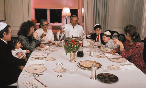 """A modern Passover meal, or seder, at which the question is still asked, """"What makes this night different from all other nights?"""""""