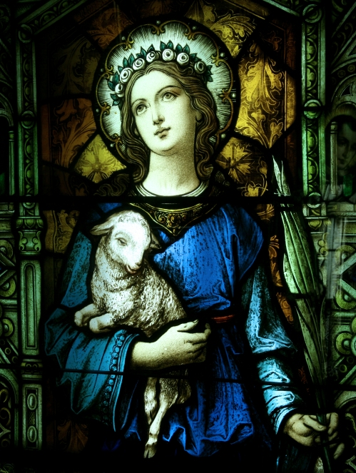 St. Agnes window at St. Ann Catholic Church, West Palm Beach, Florida. As a child of 12 she refused to worship heathen gods, despite enticements and threats, and was martyred as a threat to the Roman Empire. (S. Smith Photography)