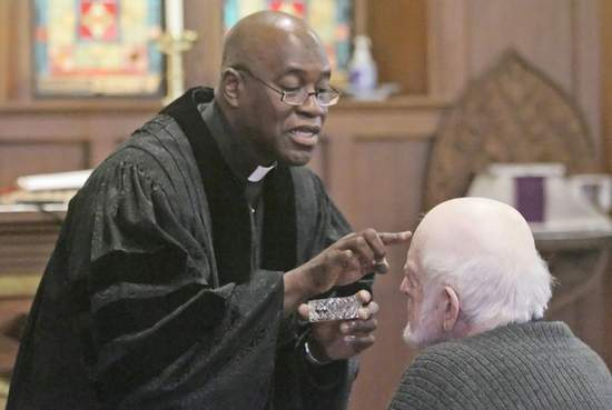Pastor from Trinity United Methodist Church, Lafayette, Indiana, administering ashes a few years ago at my home parish, St. John's. (Journal and Courier)
