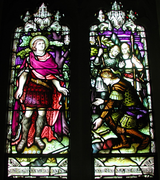 Patronal window, St. Cornelius's, Governors Island, New York City; in the left panel, he hears the call; on the right he kneels in worship.