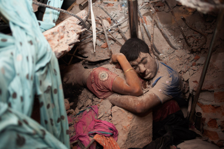 A shocking but moving photo of two victims in the rubble 24 April in Bangladesh, by Taslima Akhter.