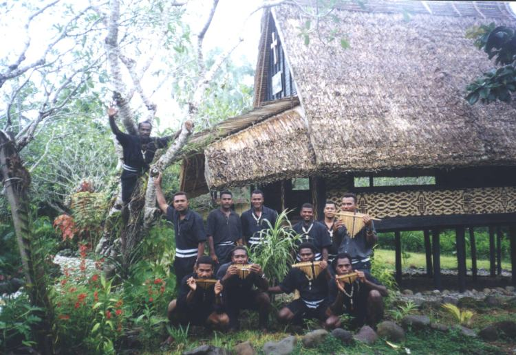 A Melanesian Brothers' chapel, and some of the men with their panpipes. One brother climbed the tree for this photo.
