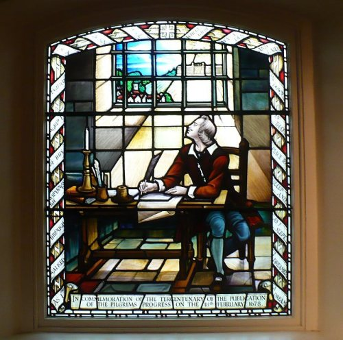 "A window of John Bunyan, depicting him during his long imprisonment in Bedford jail, where he began his masterpiece ""The Pilgrim's Progress."" (Robin Drayton/geograph.org.uk)"