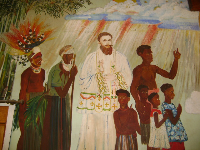 Among the many Anglican, Roman Catholic and Lutheran martyrs of New Guinea was a Fr. Morchheuser, seen in this mural at an RC church in Mingendes, Simbu, PNG. He tried to mediate an inter-tribal dispute and was killed for it in 1936. (Nancy Sullivan)