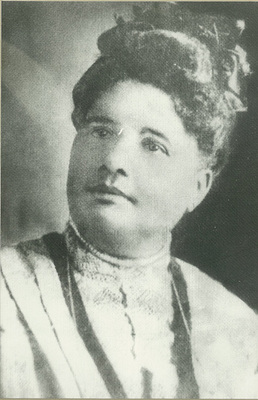 Ms. Gaudet, of African-American and Native American descent, grew up in New Orleans, Louisiana, attended Straight College, and dedicated her life from a young age to improving conditions for prisoners, eventually winning wide support from politicians and prison officials. She eventually bought a farm and built a boarding school for children of working mothers, which she donated to the Diocese of Louisiana when she retired. In 1954 this became the Gaudet Episcopal Home, and her trust lives on today as Gaudet Scholarships for African-American children.