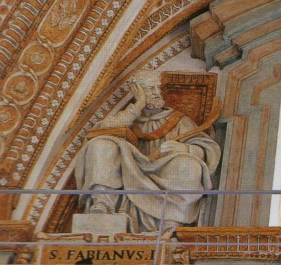 "Statue of St. Fabian at St. Peter's Basilica, Rome. He set a courageous example for his followers, many of whom suffered great torment in Decius's persecution. Fragments of Fabian's tombstone still exist, with his name and the words ""bishop"" and ""martyr"" still dimly visible."