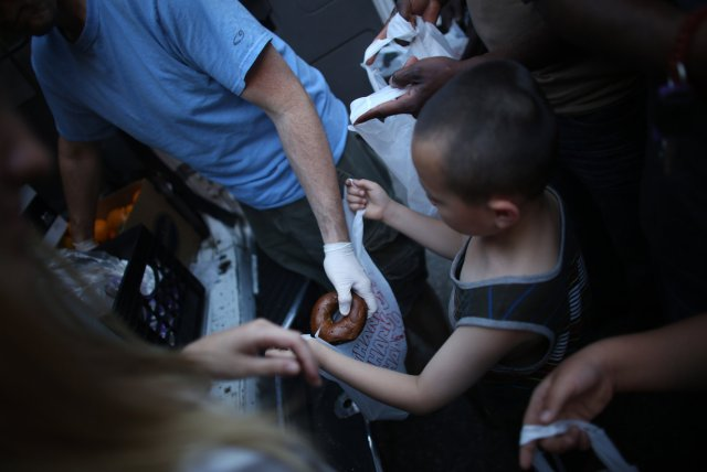 From 2014: The Coalition for the Homeless in New York sends out food trucks as mobile soup kitchens every night, but increasingly is running out of food before its rounds are done. They gather at the staging area at St. Bartholomew's, Park Avenue, then head out on designated routes around the city. At the first stop on Lafayette Street in Lower Manhattan, the driver gave out 130 meals in 15 minutes. He never made it to his last stop in the Bronx, because he ran out of food. (Chang W. Lee/The New York Times)
