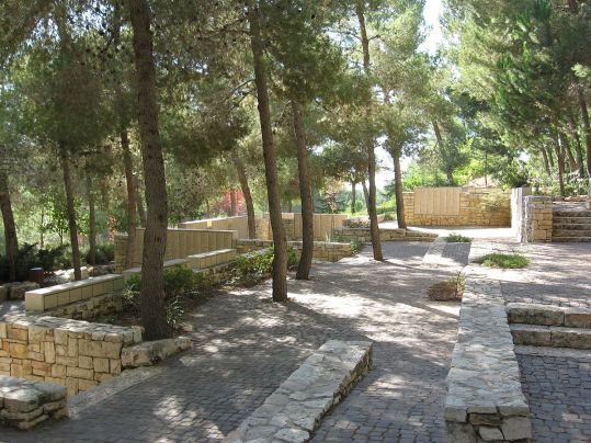 Garden of the Righteous Among the Nations at Yad Vashem in Jerusalem. In the background the Wall of Honor is visible, honoring about 25,000 Gentiles who assisted in rescuing Jews during the Holocaust. (Wikipedia)