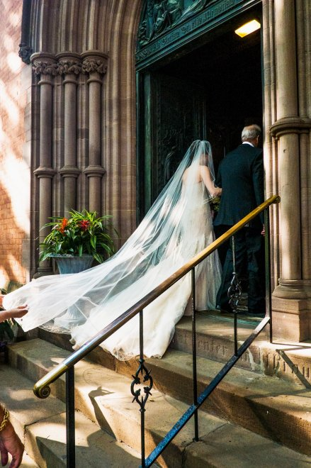 Tiler Peck on her father's arm as they enter the Chapel of the Good Shepherd at the General Theological Seminary in New York two weeks ago for her wedding to Robert Fairchild. They are both principal dancers with the New York City Ballet. We have a link to the multimedia story below; what a dress! (Devin __/The New York Times)