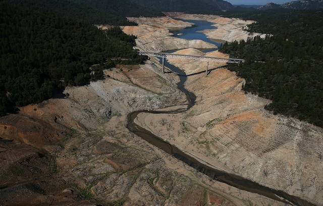Lake Oroville, California a few days ago; the western USA is experiencing an epic drought. In normal years those brown rocks are covered with blue water. (Justin Sullivan/Getty Images)