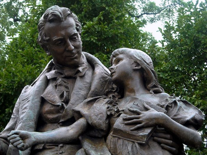 "Daniel Chester French, 1889: Thomas Gallaudet and his pupil Alice Cogswell, on the campus of Gallaudet University in Washington, D.C. He is teaching her the sign for ""A."" (Wikipedia)"