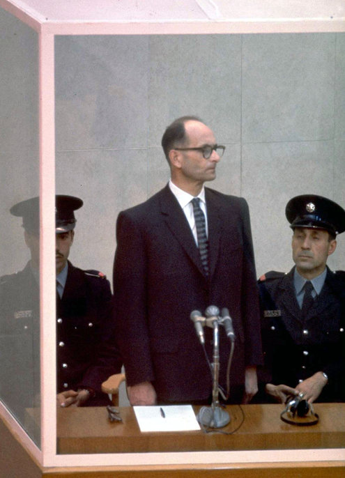 """Adolf Eichmann, the architect of the Holocaust, on trial in Jerusalem, 1961. Years ago a famous book by Hannah Arendt tried to explain his mind and behavior as reflecting """"the banality of evil,"""" but new research by ______ may finally have debunked that claim. She found that far from being a functioning robot, Eichmann believed passionately in annihilating the Jews and calculated his every move to bring it about - including how he would escape the consequences by constructing a persona of mindless conformity. He was executed in 1962. (John Milli/Israeli Government Press Office)"""