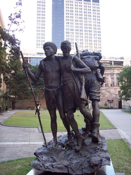 Statue in Brisbane showing Raphael Aimbari leading a blind Australian soldier to safety in New Guinea during World War II. (Wikipedia)