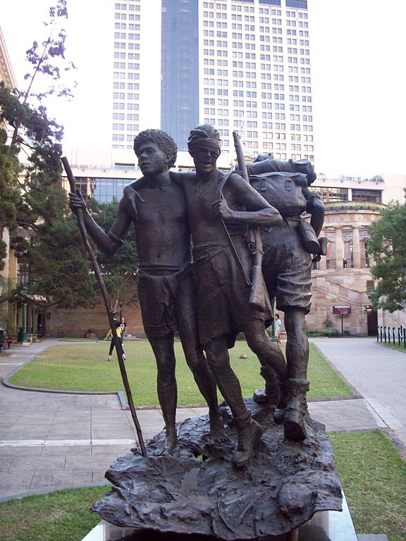 Statue in Brisbane showing Raphael Aimbari leading a blind Australian soldier to safety in New Guinea. (Wikipedia)