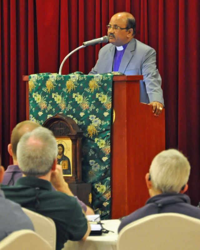 """Samuel Azariah, Presiding Bishop of Pakistan, addressing the House of Bishops of The Episcopal Church, meeting in Taipei, Taiwan. He delivered a sobering assessment of Christian-Muslim relations in his country and around the world, including a warning that """"very soon this is going to hit you, my brothers and my sisters, even in the United States."""" Azariah added a caution: """"I'm not saying that we need to fight Islam; what I am saying is that we need to recognize that reality"""" and prepare for it by learning about Islam and working to improve interfaith relations, and always searching for reconciliation. """"Islam will be the dominant religion in your own dioceses sooner or later that you will have to negotiate with,"""" he told the bishops. """"You will have large populations of Muslims around you in your areas to whom you will have to pastor to and how will you do that?"""" (Photo and reportage: Mary Frances Schjonberg/Episcopal News Service)"""