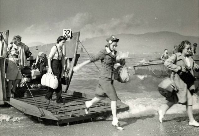 Red Cross women landing at Normandy, France, shortly after D-Day in 1944. The Allied invasion is known to all, but few people have realized women were there too. Casualties were massive; of course nurses went to help.
