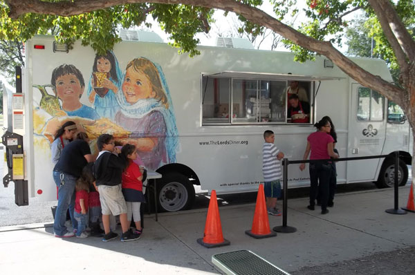The Roman Catholic Diocese of Wichita, Kansas, USA, has long fed the poor at a free restaurant called The Lord's Diner, but a few years ago they realized they could reach more people by taking the food to them; so they bought a food truck. Now they're feeding up to 2000 people a day. (LoyolaPress.com)