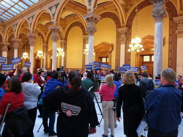 A rally last week at the Indiana Statehouse against a bill creating a religious exemption to local anti-discrimination ordinances, allowing businesses to refuse to serve LGBTs. The bill, trumpeted to protect those who disapprove of same-sex marriage, doesn't limit the type of business or specify what kinds of customers can be turned away; critics say anyone could be a target. It passed yesterday, with five Republicans joining Democrats voting against it. (John Steele)