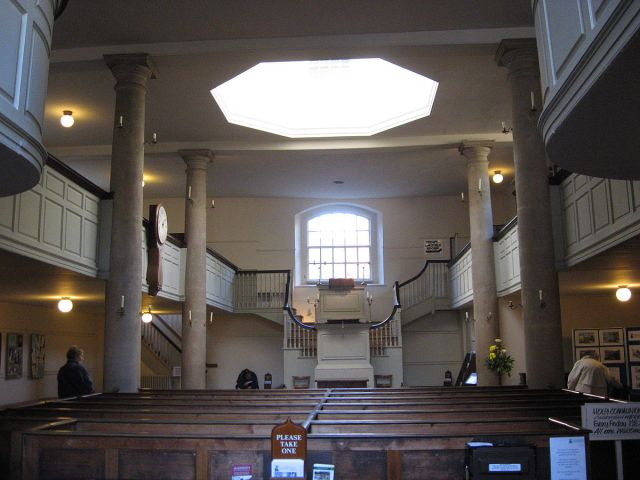 The New Room in Bristol, England, where John Wesley preached, is the oldest Methodist church in the world, and features a double-decker pulpit - making preaching, not Communion, the central activity. (Wikipedia)