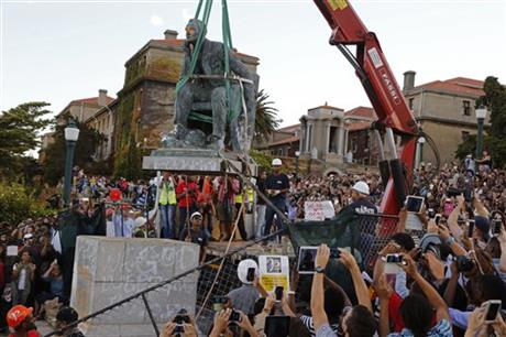 """A statue of Cecil Rhodes being removed last week from the campus of the University of Cape Town. Thousands of students of all races gathered to watch, cheer and take photos. Son of an Anglican priest, Rhodes acquired diamond mines and became one of the world's richest men. He believed the British were a """"master race"""" and even hoped to see the United States rejoin Britain to rule the world."""
