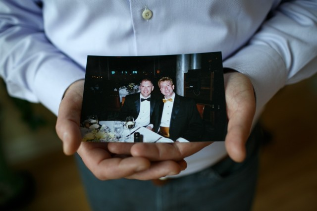 Jim Obergefell holds an old photograph of him and his late husband John Arthur. The two men, from Ohio, were married in 2013 in Maryland, having flown there in a specially equipped medical plane to wed a few days before John died of ALS, known as Lou Gehrig's Disease. Their home state would not marry them. After John died, Ohio refused to list Jim as his surviving spouse; Jim sued, and that case will be argued before the United States Supreme Court today, in what's expected to be a landmark ruling one way or the other on whether same-sex marriage is a Constitutional right. (Maddie McGarvey/Washington Post)