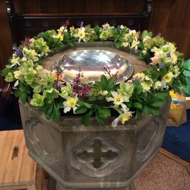 Baptismal font at St. John's, Lafayette, Indiana, with a child's step stool at the ready in the lower left. (parish photo)