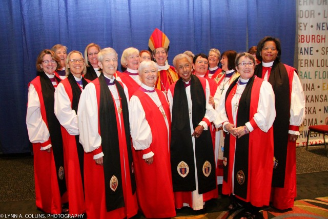 Women bishops of The Episcopal Church at the In-gathering of the United Thank Offering. It's kind of cool that Katharine stood in the back to let the other women be seen - though she does stand out with that pointy hat.
