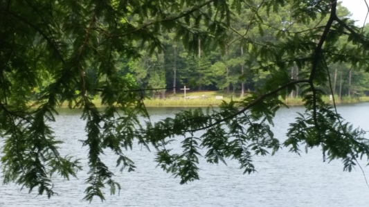 View across the lake from one outdoor chapel to another at Camp Bratton-Green in the Diocese of Mississippi. (Tom Welch)
