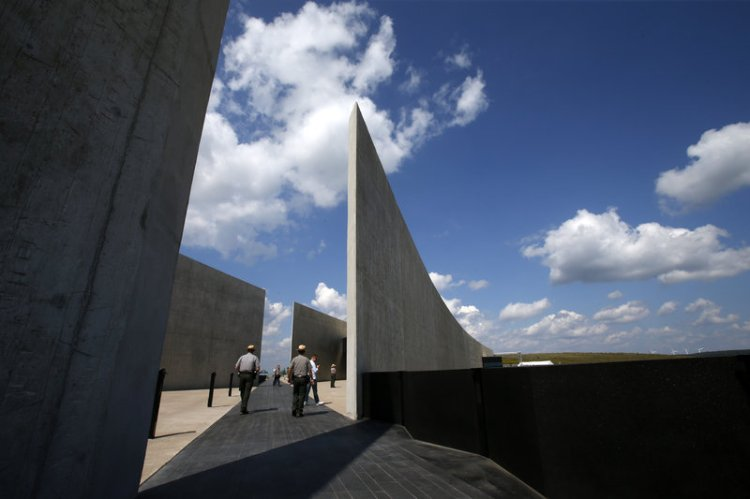 Fourteen years after 9/11, the Flight 93 National Memorial opened in Shanksville, Pennsylvania yesterday; the black granite path above shows the flight path of the airliner commandeered by Al Qaeda terrorists and intended to crash into the U.S. Capitol. The 40 passengers and crew fought off the highjackers instead, forcing it to crash in this unpopulated area. The events that day created a lot of heroes, none more so than those passengers and crew. (Gene J. Puskar/Associated Press)