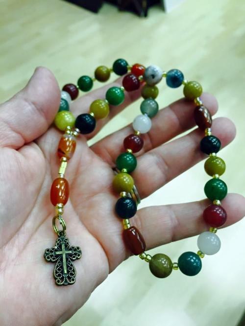 """Deacon Letha's Anglican rosary, which we made at our Daily Office retreat last month. It consists of four """"weeks"""" of 7 days, with 33 beads in all, for the years of Christ's life. (dailyoffice.org)"""