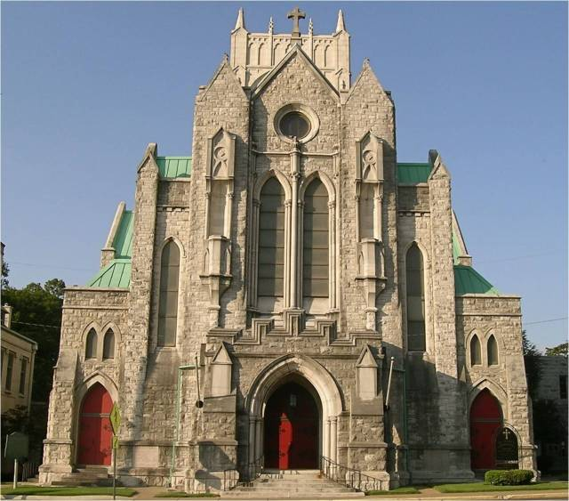 St. Mary's Cathedral, Memphis, Tennessee. It has helped the city respond to two major crises in its history; besides the yellow fever epidemic of 1878, it was the scene of a dramatic march after the assassination of Dr. Martin Luther King Jr. in 1968. Clergy from many churches and synagogues gathered there for an emergency meeting after which the Dean, William Dimmick, picked up the processional cross and led the way to City Hall to ask the mayor to settle the sanitation workers' strike which had brought King to the city. Dimmick's heroic leadership nevertheless led to a backlash among his white parishioners; half of them left and never went back. (originalmemphis.org)