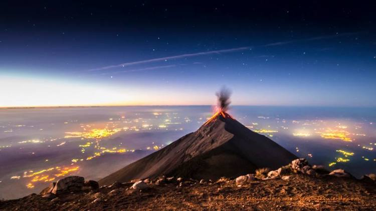 Sunrise over the Volcano of Fire in Guatemala. Sun and moon and stars of the sky, glorify the Lord, * sing praise and give honor for ever.
