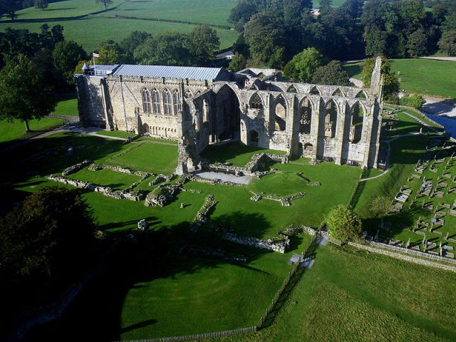 The parish church (left) and ruins at Bolton Priory in North Yorkshire, an Augustinian monastery built in 1154. It survived the Dissolution of the Monasteries and remains a religious community today, part of a massive estate owned by the Duke of Devonshire and administered by a trust. (Dr. John Wells)