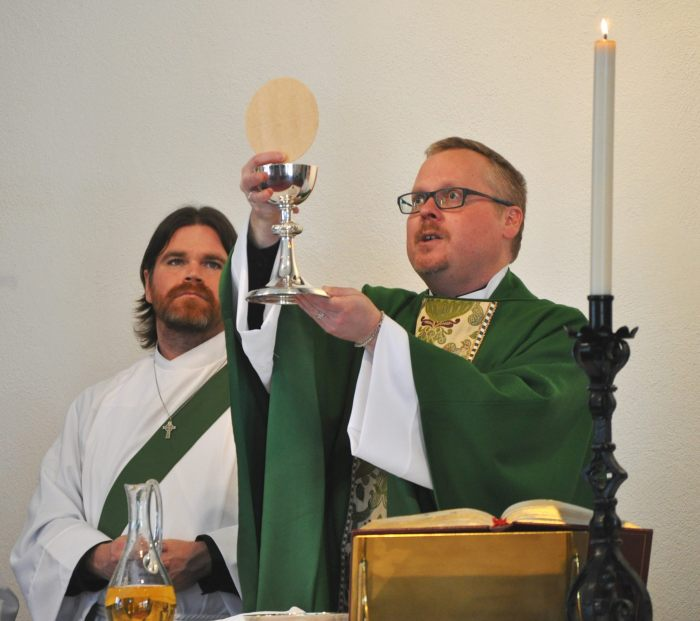 Newly ordained deacon Brian Barry serving at his first Mass last Sunday at St. Luke's, Wantagh, New York, with the rector Christopher Hofer. (Facebook)