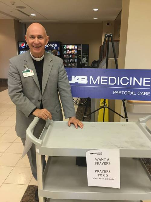 The Rev. Malcolm Marler, head of chaplaincy services at the University of Alabama Medical Center in Birmingham, has hit upon a new (or old) idea this Lent, setting up a table in his hospital and offering Prayers to Go for anyone passing by. I think of it as a variation on Ashes to Go, a popular offering by American churches on Ash Wednesday. Malcolm set up a music player to muffle people's voices for privacy's sake, and served 100 people for a minute each - visitors, patients, staff, whoever happened by and asked for a good word. The Daily Office has a lot of ordained, lay and student chaplains in a variety of settings, and this photo aims to support them in their important work. (Malcolm Marler on Facebook)