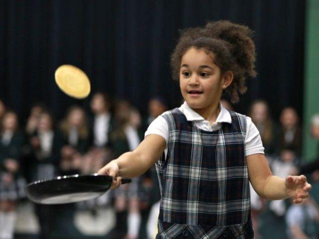 Pancake Race, Run & Flip last year on Shrove Tuesday at St. Richard's School, Indianapolis. (Kelly Wilkinson/The Indianapolis Star)
