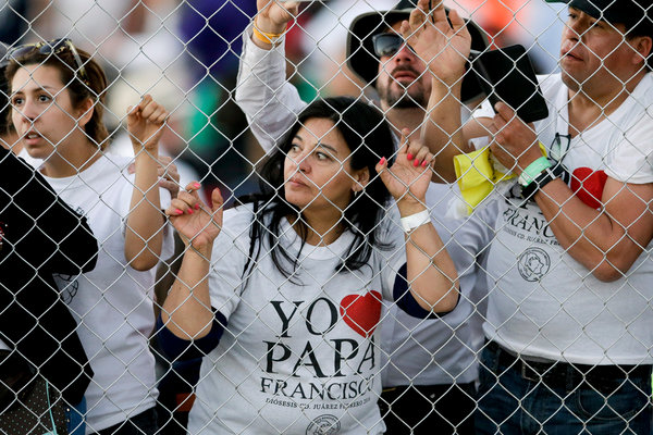 Yo Papa! Waiting at the Papal Mass Wednesday in Ciudad Juárez, México, across from El Paso, Texas. (Gregory Bull/Associated Press)