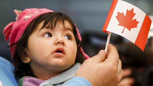 The 25,000th Syrian refugee arrived in Canada on Saturday, fulfilling Prime Minister Trudeau's campaign pledge last year. South of the border in Indiana, a U.S. Federal judge blocked the governor's ban on admitting Syrian refugees, saying the governor offered no legal justification for such discrimination. The governor is in a tight race for re-election. (Mark Blinch/Reuters)