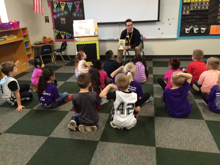 Real Men Read: The Rev. Gray Lesesne, vicar of Good Samaritan, Brownsburg, Indiana, reading to public schoolchildren. This Episcopal congregation bills itself as a church without walls, a phrase they stole from us (or we lent to them).