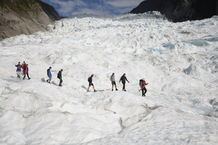 New Zealand's Fox Glacier, like most others, is melting rapidly - but unlike most, people feel its loss of mass directly. It has long served recreational tourists in a national park on the South Island, flowing down between mountain peaks to a temperate rain forest in the valley below; people used to be able to walk right up. But the ice has receded so much that now the only way to climb it is by helicopter, with hikers limited to 80,000 a year. Since the turn of the last century, the Fox and Franz Josef Glaciers have both retreated about 3 kilometers, leaving the exposed mountains subject to dangerous rock slides. (Nick Perry/Associated Press)