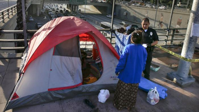 Police swept the homeless off their village above the 101 Freeway last week in Los Angeles. (Mark Boster/Los Angeles Times)
