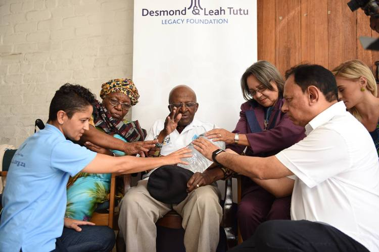 Archbishop Emeritus Desmond Tutu, his wife Leah and local dignitaries blessed bottled water yesterday in the face of South Africa's worsening drought. It is part of a campaign to encourage water collection and the distribution of supplies to the hardest hit areas. Let us pray for rain; there is no life without water. (Oryx Media)