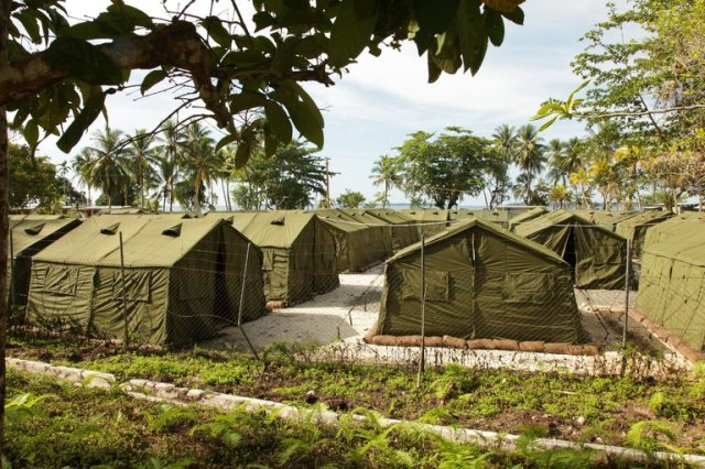 This Australian-run detention center for 800 immigrant/refugee men on Manus Island in Papua New Guinea was declared illegal yesterday by the highest court in PNG. The Australian government immediately declared that its immigration policies will not change. There are additional camps in Papua for women and children. Meanwhile we note that a photo of tents is not the same as a picture of human beings. (Australian Department of Immigration and Citizenship)