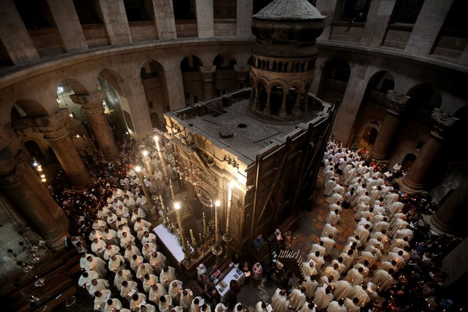The status quo may be about to change at the Church of the Holy Sepulcher in Jerusalem, after more than a century of petty jealousy and bickering among the three denominations that claim it as the site of Christ's tomb. At a joint news conference, representatives of the Greek Orthodox, Armenian Apostolic and Roman Catholics agreed to go forward with $3.5 million in repairs to keep the structure from falling down on their heads. The work will start after Orthodox Easter in May, and each church will (naturally) appoint its own architect - so that they can do the arguing and fistfighting instead of the monks. (Gail Tibbon/AFP)