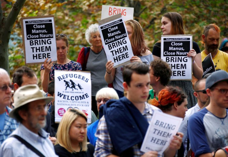 Demonstrators Friday at the Department of Immigration and Border Protection in Sydney, protesting the indefinite offshore detention of Rohingyas, mostly from Burma. (David Gray/Reuters)